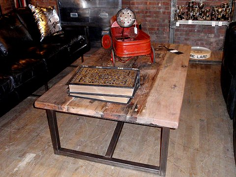 I really like the salvaged wood on this coffee table